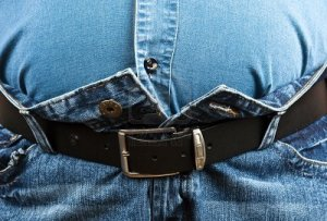 9346134-fat-man-can-t-close-jeans