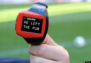 """A FIFA officer displays a watch displaying """"goal"""" during a demonstration of new goal-line technology by Hawk-Eye Innovations at Toyota Stadium in Toyota, Aichi prefecture on December 8, 2012 which is being used in the 2012 Club World Cup tournament in Japan. Hawkeye, which is familiar from tennis and cricket and uses cameras to track a ball's position and trajectory, will be tested at the competitions in Toyota.  The ninth edition of the FIFA Club World Cup football tournament is taking place from December 6 to 16.    AFP PHOTO / TOSHIFUMI KITAMURA        (Photo credit should read TOSHIFUMI KITAMURA/AFP/Getty Images)"""