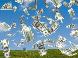 money falling in the sky and green grass background