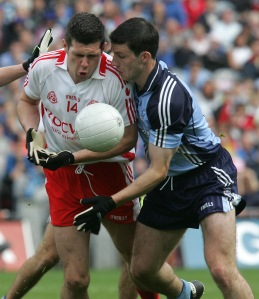 Sean Cavanagh and Dublin's Colin Moran trying to get control of this loose ball