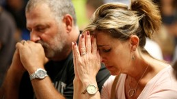 People pray during a vigil for the victims of a mass shooting in Las Vegas